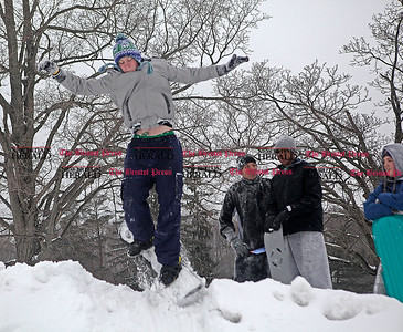 Chris Richie | Staff CCSU student Ethan Falla snowboards at Stanley Quarter Park in New Britain with his friends Kyle Davis, Greg Brown and Lauren Mazzoni during a snowday from classes. (2/1/11)