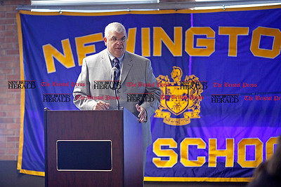 Chris Richie | Staff Town manager John Salomone speaks during Newington's annual state of the town at Newington High School on Thursday. (2/10/11)
