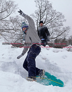 Chris Richie | Staff CCSU student Ethan Falla wipes out sledding as his friend Kyle Davis looks on at Stanley Quarter Park in New Britain during a snow day. (2/1/11)