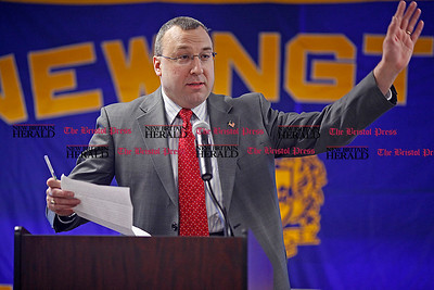 Chris Richie | Staff Newington chamber of commerce president John Kelly speaks during Newington's annual state of the town at Newington High School on Thursday. (2/10/11)