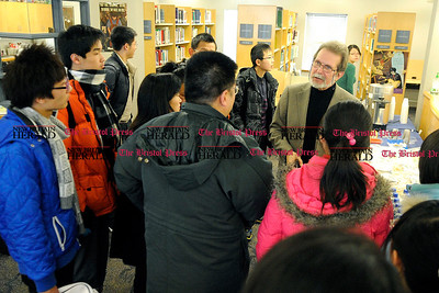2/11/2011 Mike Orazzi | Staff Bristol Eastern High School Dr. Steve Wysowski meets with Chinese visitors during a brief stop on Friday morning before heading off to Yale University and New York City.