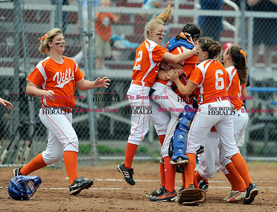 6/12/2010 Mike Orazzi | Staff Terryville girls celebrate after winning the  Class S State Softball Final over the St. Bernard Saints at DeLuca Field in Stratford, Conn. on Saturday, June 12, 2010.