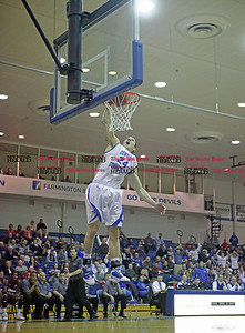 Chris Richie | Staff Robby Ptacek dunks during the CCSU mens basketball game at home versus UMass. (1/3/11)