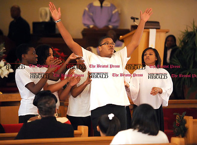 1/1/2011 Mike Orazzi | Staff AME Zion Youth Praise Dancers during the New Britain Branch NAACP Emancipation Day Program at the Spottswood A.M.E. Zion Church in New Britain on Saturday.