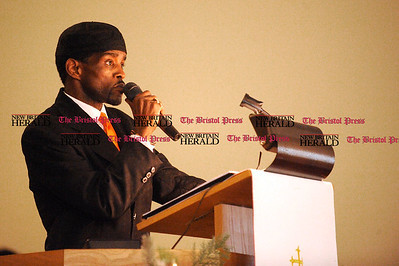 1/1/2011 Mike Orazzi | Staff Former state senator Ernie Newton gives the keynote speech during the New Britain Branch NAACP Emancipation Day Program at the Spottswood A.M.E. Zion Church in New Britain on Saturday.