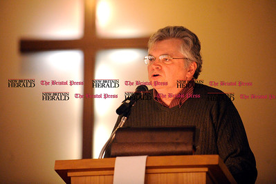 1/1/2011 Mike Orazzi | Staff John McNamara, Democratic town committee chairman, introduces former state senator Ernie Newton gives the keynote speech during the New Britain Branch NAACP Emancipation Day Program at the Spottswood A.M.E. Zion Church in New Britain on Saturday.