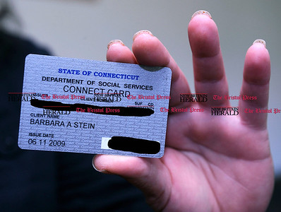 7/1/2011 Mike Orazzi | Staff Barbara Stein holds her food stamps card.