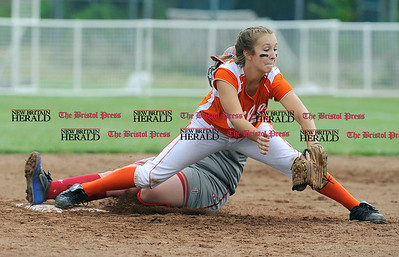 6/12/2010 Mike Orazzi | Staff Terryville's Anna Dupual (17) gets a force out on St. Bernard Saints' Tara Kowalski at second base on a bunt during the Class S State Softball Final at DeLuca Field in Stratford, Conn. on Saturday, June 12, 2010. Terryville went on to win 2-0.
