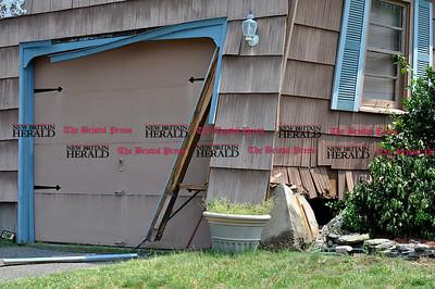 6/1/11 Kayla Adams | Staff The leftover damage on Doris West's garage from a car crash.