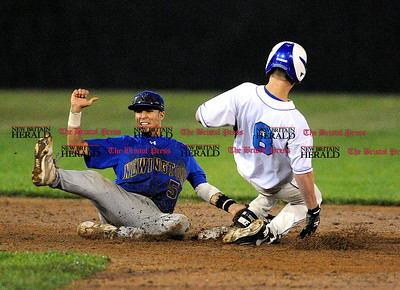 6/11/2011 Mike Orazzi | Staff Newington's Armando Soler (5) tags out Southingtons' Matthew Spruill (8) on a steal of second during the Class LL Baseball Final at Muzzy Field in Bristol on Saturday night.