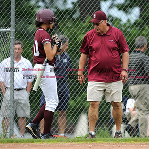 6/1/2011 Mike Orazzi | Staff Bristol Central's Chandler Walker (20) and Phil Pirog during Wednesday's softball game with Simsbury at BC.