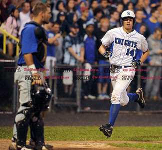 6/11/2011 Mike Orazzi | Staff Southington's Sal Romano (14) scores during the Class LL Baseball Final at Muzzy Field in Bristol on Saturday night.