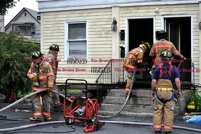 6/1/11 Kayla Adams | Staff Bristol Fire Fighters seen on scene from fire aftermath at 110 South Street in Bristol.