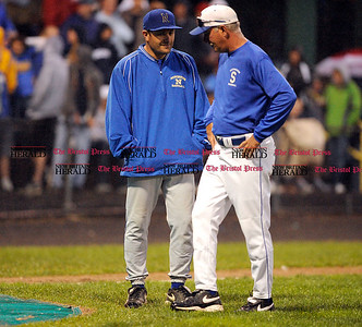 6/11/2011 Mike Orazzi | Staff Newington's Eric Frank and Southington's Charles Lembo during the Class LL Baseball Final at Muzzy Field in Bristol on Saturday night.