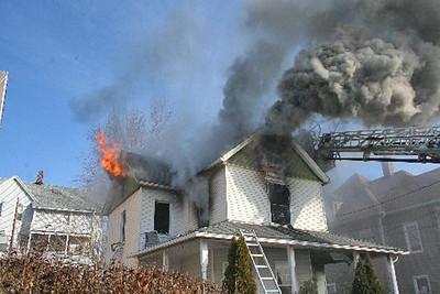 Submitted NBFD firefighters tend to a fire on 376 Chestnut St. in New Britain. (3/1/11)