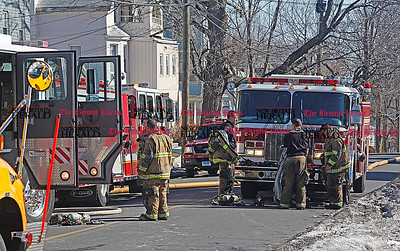 Chris Richie | Staff NBFD firefighters finish fighting a fire on 376 Chestnut St. in New Britain. The fire department first received the call at 9:04AM. (3/1/11)