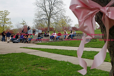 Chris Richie   Staff New Britain High School student volunteers take a lunch break in between tieing nearly a thousand pink ribbons across Walnut Hill Park in preperation for the 2011 CT Race in the Park this Saturday in New Britain. (5/2/11)