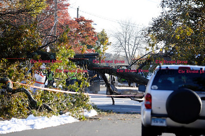 11/01/2011 Mike Orazzi | Staff A large tree still blocking Garfield Road near the intersection with Highview Street on Tuesday afternoon.