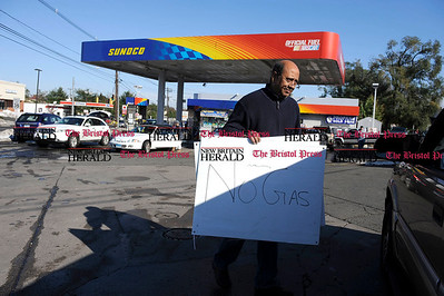 11/01/2011 Mike Orazzi | Staff Rashid Sherwani informs motorist that the Sunoco station at the intersection of Route 6 and King Street has run out of gas because of storm related high demand.