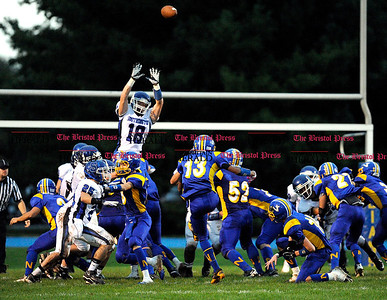 10/1/2011 Mike Orazzi | Staff Southington's Matthew O'Connor (18) as Newington's Christian Beauford  (13) misses a field goal on Saturday night at Newington High School.
