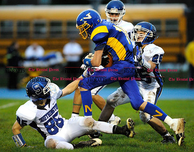 10/1/2011 Mike Orazzi | Staff Southington's Brian Kaminsky (85), Corbin Garry  (25) and Newington's Zachary Morris  (10)) on Saturday night at Newington High School.