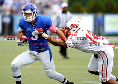 10/1/2011 Mike Orazzi | Staff CCSU's Raul DeBenendittis (3) and Sacred Heart's Gordon Hill (12) at Arute Field in New Britain on Saturday afternoon.
