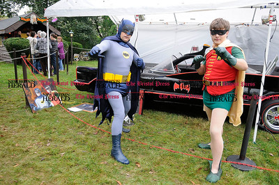 10/1/2011 Mike Orazzi | Staff Batman Leon Wasiak and Robin Ryan Wasiak with the Batmobile while at the Witch's Dungeon on Battle Street in Bristol on Saturday.