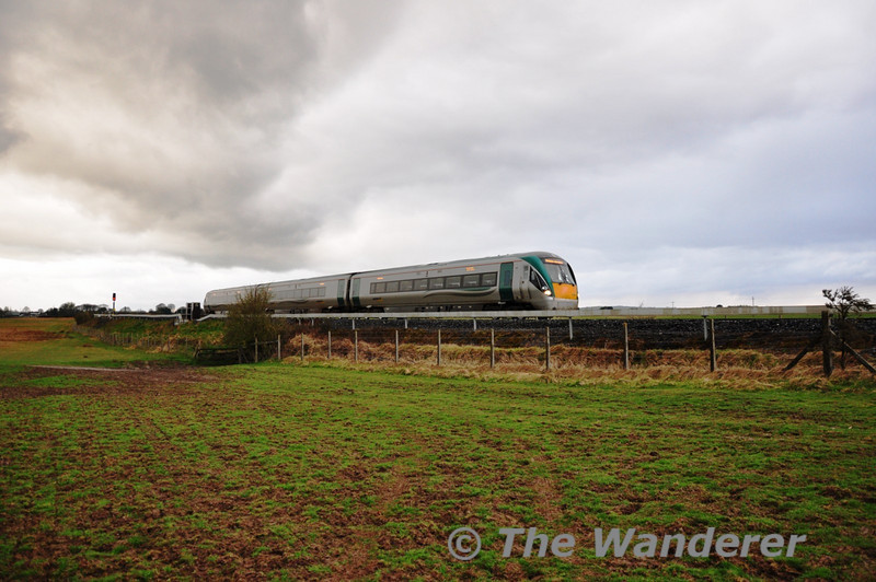 22001 gets away from a signal check in the Curragh with the 1650 Waterford - Heuston.  Sat 02.04.11
