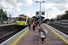 Two passengers with bikes get directions from a station staff member as 4004 arrives at Mallow with the 1630 Cork - Heuston. Sun 17.04.11