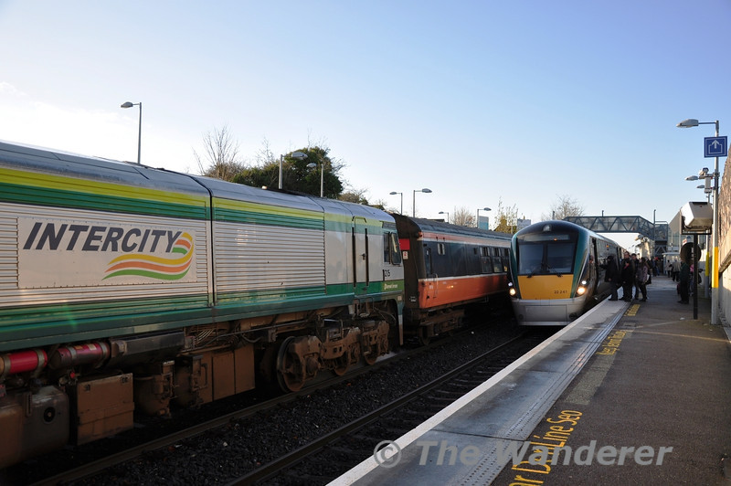 Passengers board 22041 for the Express run to Dublin Connolly while 215 waits to depart with the 1200 Maynooth - Pearse RPSI Special. Sat 17.12.11