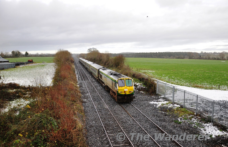 On Wednesday 14th December 2011 the Irish Midlands had a light sprinkling of snow. 229 is pictured passing Ratheven, outside Portlaoise with the 1300 Heuston - Cork.