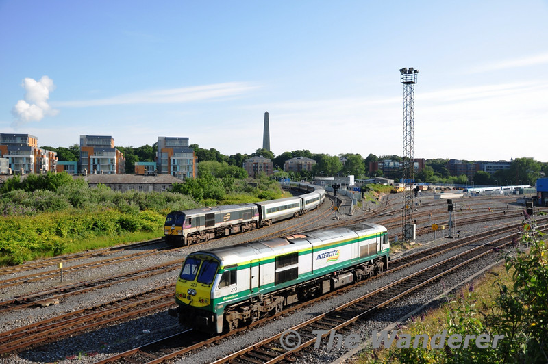 223 runs Light Engine from Inchicore to Heuston Station while 230 waits to depart Islandbridge Jct with a rake of De-Dietrich Coaches from York Road to Inchicore. Sat 02.07.11