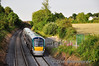 22023 has just left Portarlington and passes Deerpark Bridge with the 1840 Heuston - Portlaoise. Wed 13.07.11
