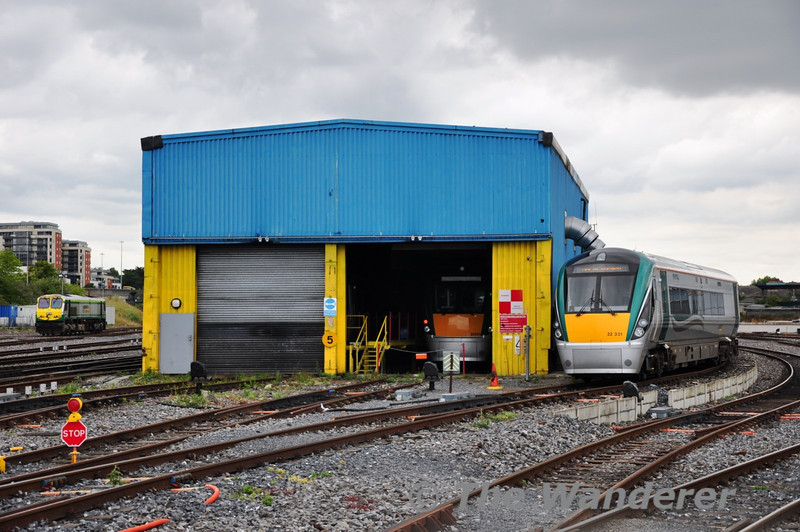 """Brand New 22050 peeks its head out of the Rotem Facility at Heuston while 22031 is stabled in the carriage siding no. 1 after coming from Laois Train Care. It would later form the 1630 to Galway. To the left 217 arrives from Inchicore on the """"Taxi"""" job. Sat 02.07.11"""