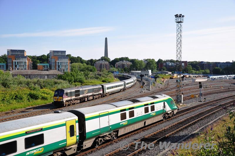 The 0615 Cork - Heuston Express led by 4006 passes 230 and the De-Deitrich coaches at Islandbridge Jct. Sat 02.07.11