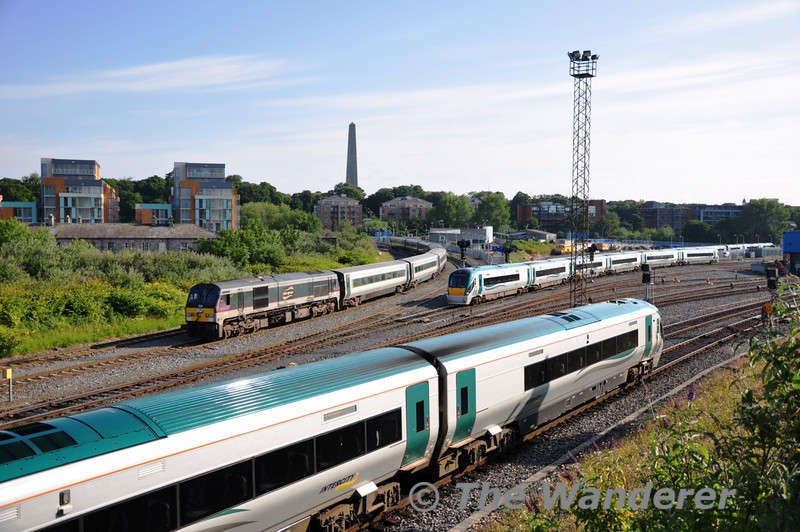 """In the foreground is 22028 which is shunting from the station to the """"St. John's Road Sidings"""", in the middle is 22045 departing Heuston with the 0830 Heuston - Portlaoise while 230 waits with De-Deitrich coaches from Belfast York Road to Dublin Inchicore for MKIII Gen Van tests with 89605. Sat 02.07.11"""