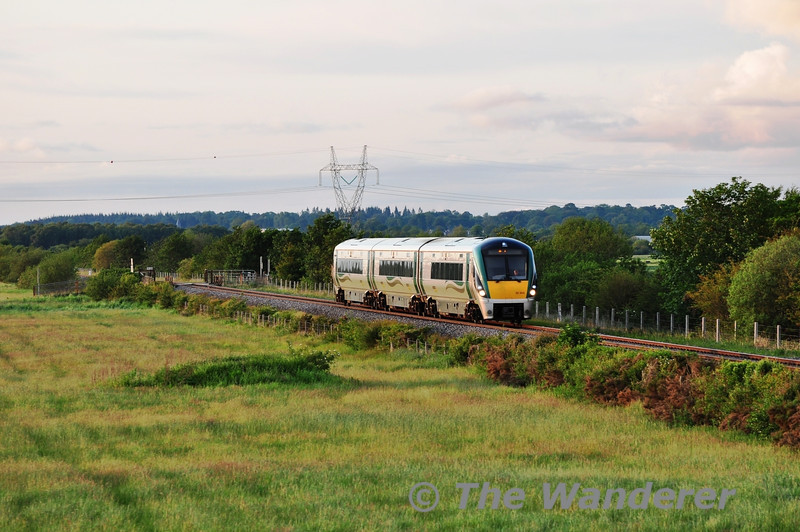 22005 passes Cloney between Athy and Kildare with the 2010 Heuston - Carlow. Tues 07.06.11
