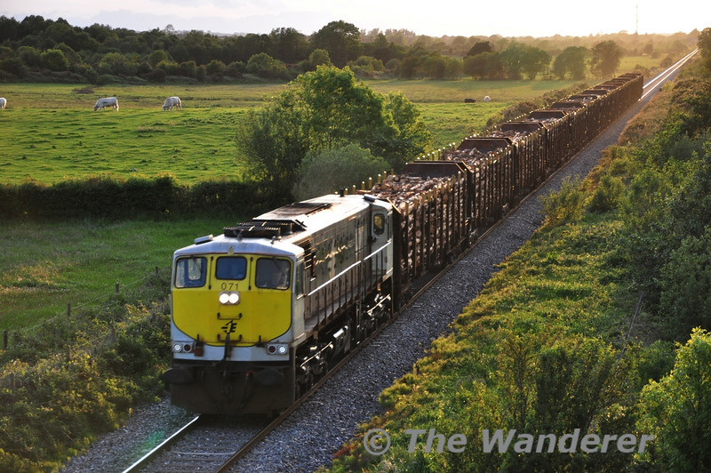 "Last night the Timber train from the West of Ireland had Iarnrod Eireann's last built diesel locomotive No. 234 which entered traffic on 30.05.95. Tonight the 1655 Ballina - Waterford Timber had Iarnrod Eireann's  first built ""big"" locomotive No. 071 which coincidentally entered traffic 18 years earlier on the same date in 1977! It is seen passing Shanderry on the outskirts of Portarlington on the way to the South East of the Country. Wed 08.06.11"