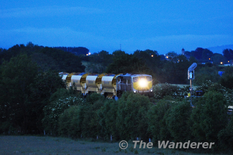 Running some two hours late the 1855 North Wall - Ballyhale Autoballaster train eventually appeared at Cherryville Junction just after 2215 hrs. In poor light it is seen held at the signal waiting for the timber train to clear the single line section to Athy. Tues 07.06.11