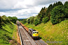 The 0950 Belview Port - Portlaoise Steel Train which carries imported rails is seen climbing the hill from Cherryville Jct towards Kildare with 075 at the helm. Sat 11.06.11