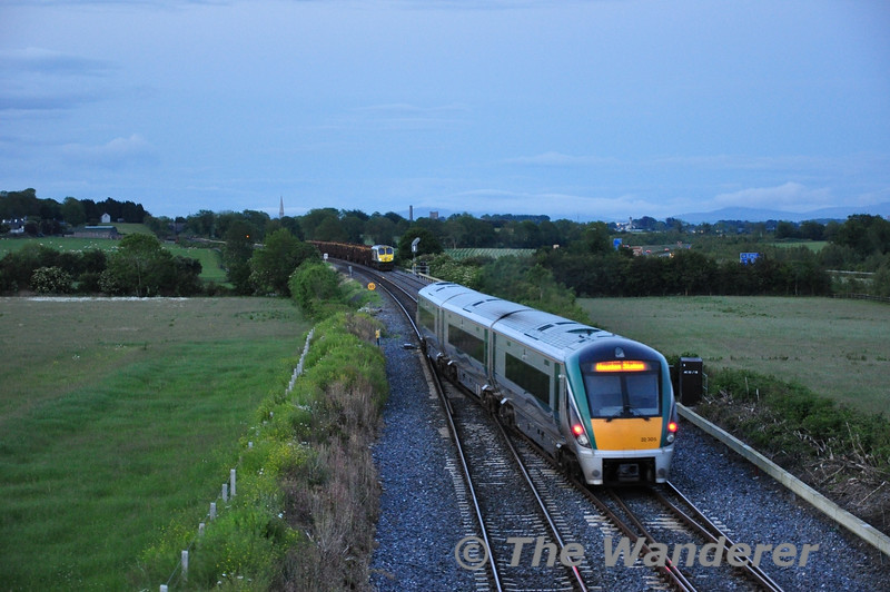 22005 crosses from the down line to the up line at Cherryville Jct with the 2135 Carlow - Heuston while 234 waits for the road to Waterford. Tues 07.06.11