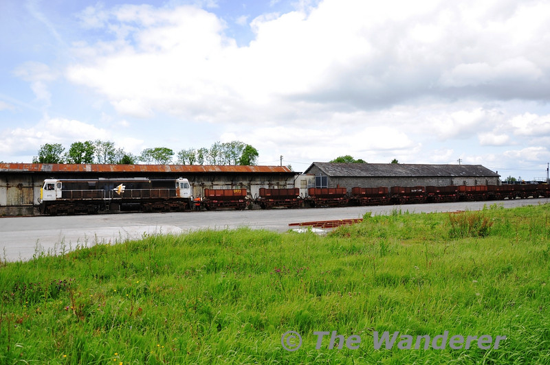 On Tuesday 31st May 073 shunted a rake of withdrawn ballast wagons into a siding in the former Portlaoise Goods Yard for storage.