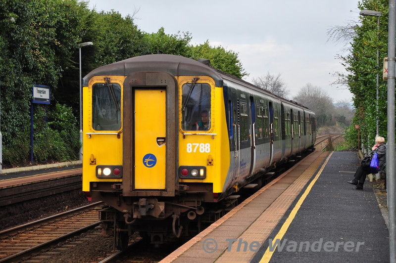 The 1300 Carrickfergus - Belfast Central at Trooperslane with 8458. Mon 21.11.11