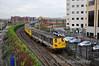 The 1517 Bangor - Belfast Central Sandite working arrives at Belfast Central. The Sandite train is formed of 8094 + 8097 + 8752 + 8090. Mon 21.11.11