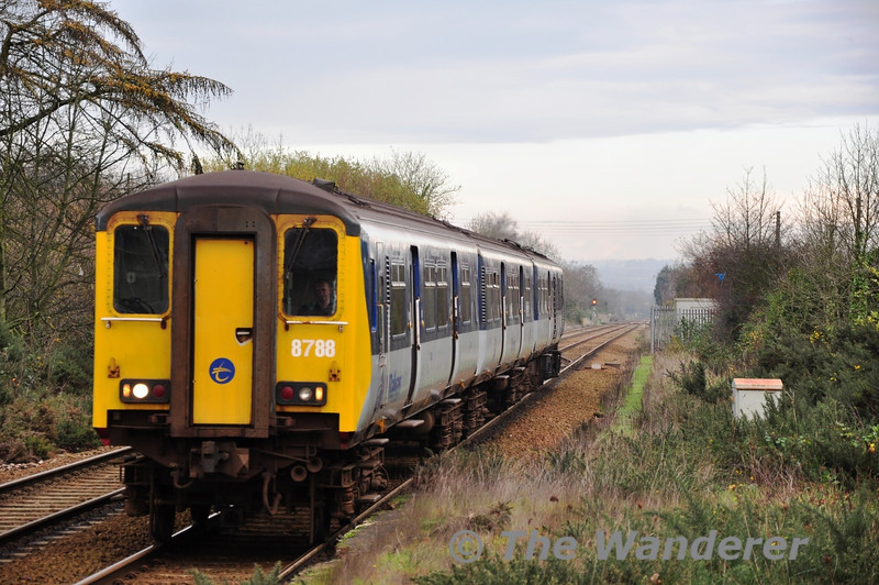 There was only one off peak 450 class unit working on the Larne Line on this day. Unit 8458 arrives at Greenisland with the 1157 Larne Harbour - Belfast Central. Mon 21.11.11