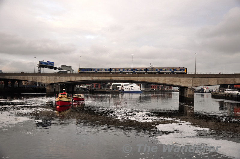 8458 crosses the Cross Harbour Link Bridge with the 1442 Belfast Central - Larne Town. Mon 21.11.11