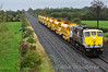 After being looped in Portlaoise Station Loop to allow the 1100 Heuston - Cork to overtake, 083 passes Clonkeen with an empty rake of Autoballaster Wagons from North Wall to Charleville. Fri 30.09.11