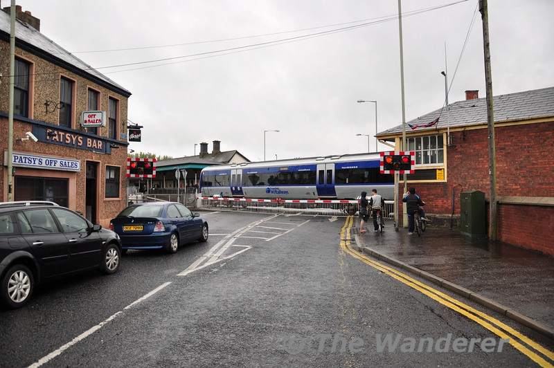 3002 crosses the Level Crossing at Coleraine with the 1323 Derry - Belfast Great Victoria Street. Sun 25.09.11