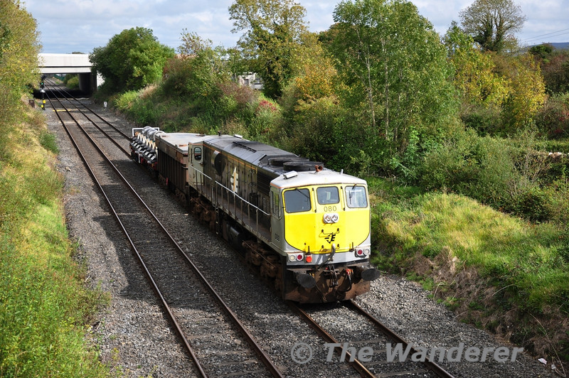 """080 was entrusted to the Limerick """"Wheel Carrier"""" transfer on Tuesday 27th September 2011 which also had a Tara Mines wagon going to Limerick Wagon works for attention. The train is seen passing Clonkeen enroute to Limerick. Tues 27.09.11"""