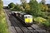 "080 was entrusted to the Limerick ""Wheel Carrier"" transfer on Tuesday 27th September 2011 which also had a Tara Mines wagon going to Limerick Wagon works for attention. The train is seen passing Clonkeen enroute to Limerick. Tues 27.09.11"